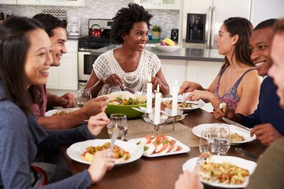 Group Of Friends Enjoying Dinner Party At Home